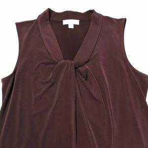 Eggplant color sleeveless blouse.